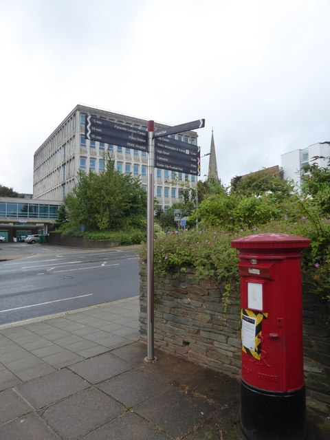 A redundant postbox and council office building
