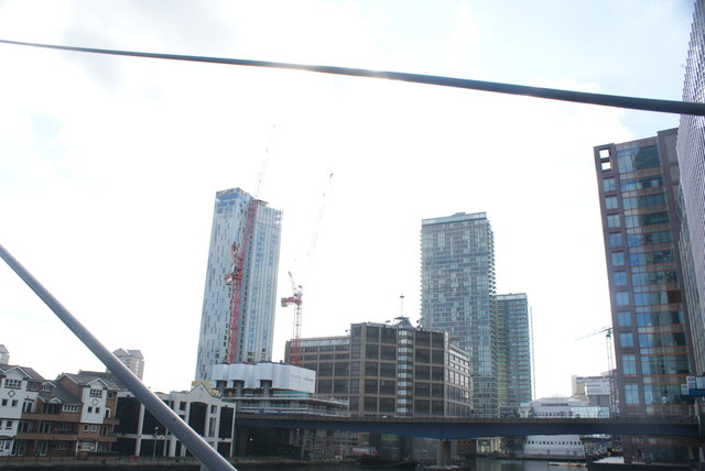 View of Hotel Novotel Canary Wharf, Britannia Hotel and Pan Peninsula apartments from the footbridge leading from South Quay