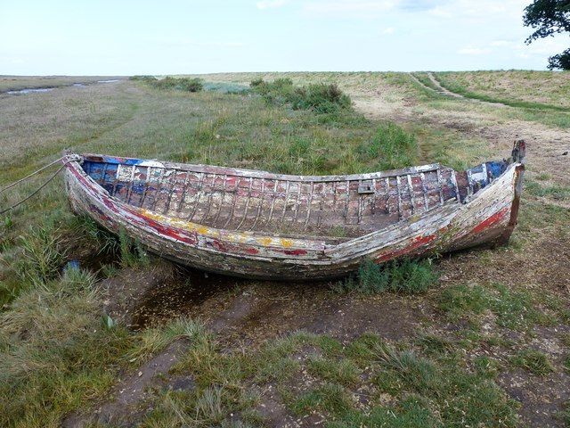 Boat on the edge of the salt marsh at Burnham Deepdale