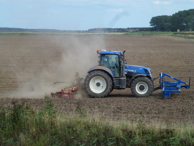 Tractor at work on reclaimed salt marsh at Burnham Deepdale