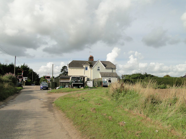 The gate house and crossing near Morston Hall