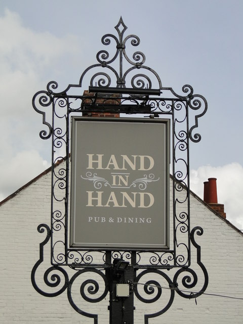 Hanging sign for the Hand in Hand