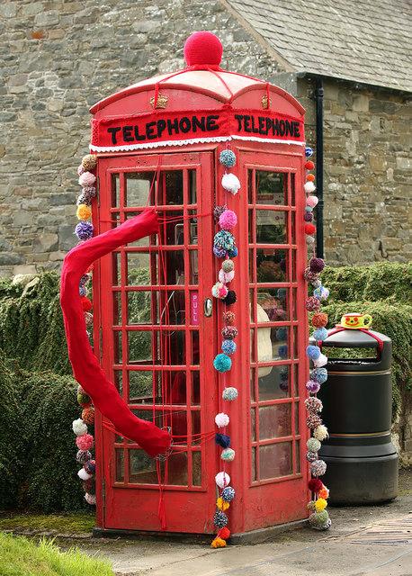 A yarn bombed telephone box at Ettrickbridge