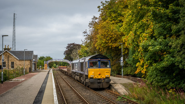 Empty freight train waiting at Tain