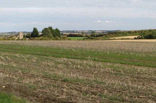 Middle farm across a stubble field
