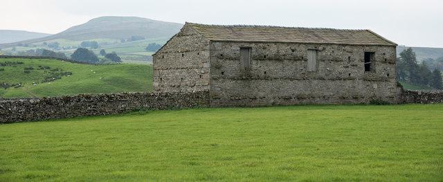 Field barn built into wall