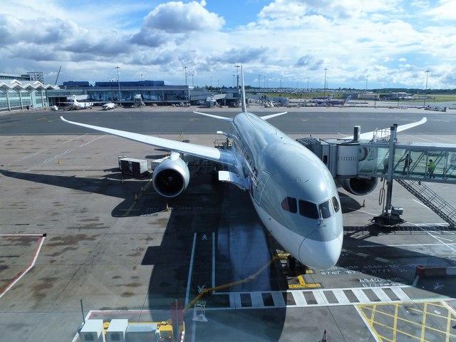 Boarding a Qatar plane at Birmingham Airport
