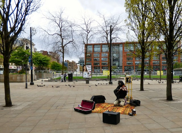 A classical busker by Piccadilly Gardens
