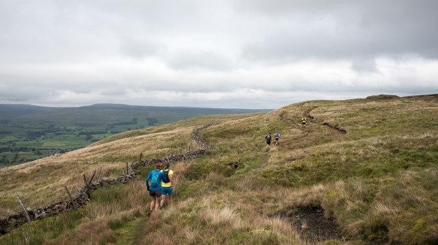 Runners in fell race crossing slopes of Wether Fell/Drumaldrace