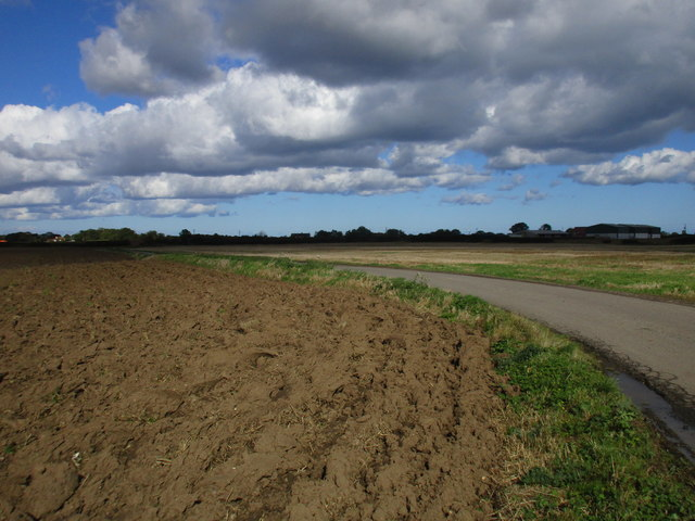 Ploughed field and bend in the road