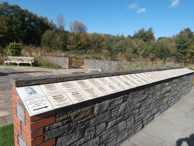 Memorial wall in the Welsh National and Universal Mining Memorial Garden, with names of victims of the 1901 Universal Colliery d