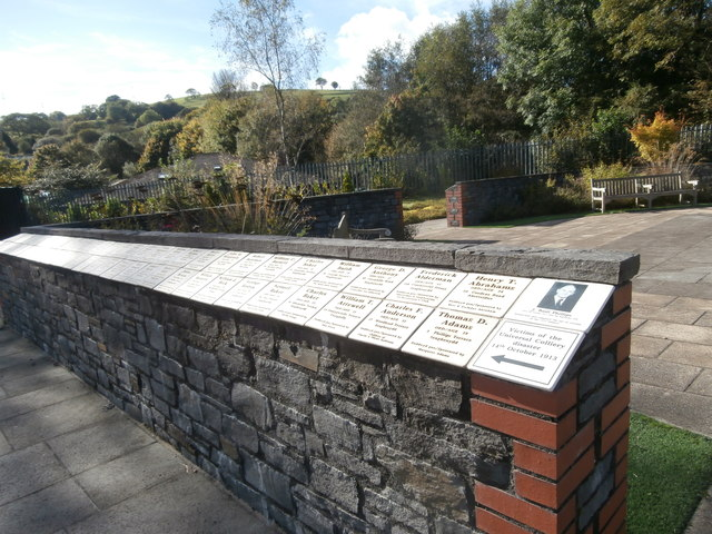 Memorial wall in the Welsh National and Universal Mining Memorial Garden, with names of victims of the 1913 Universal Colliery d
