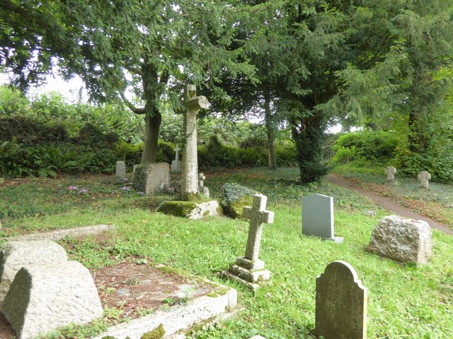 Gravestones and the churchyard cross, Cadbury