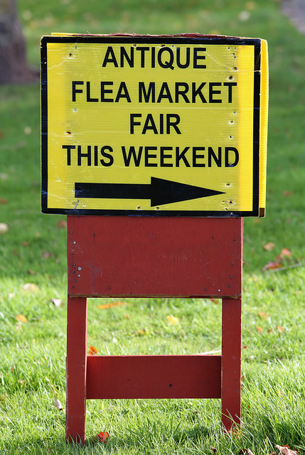A sign for an antique fair at Kelso