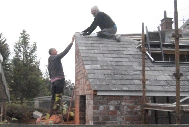 Roofing a house extension in Anglesey Terrace, Greenore