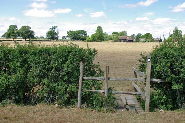 Stile and footbridge, path towards Dean Farm