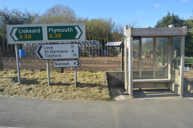 Road sign and bus stop, Landrake
