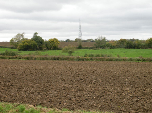 Ploughed field with radio mast