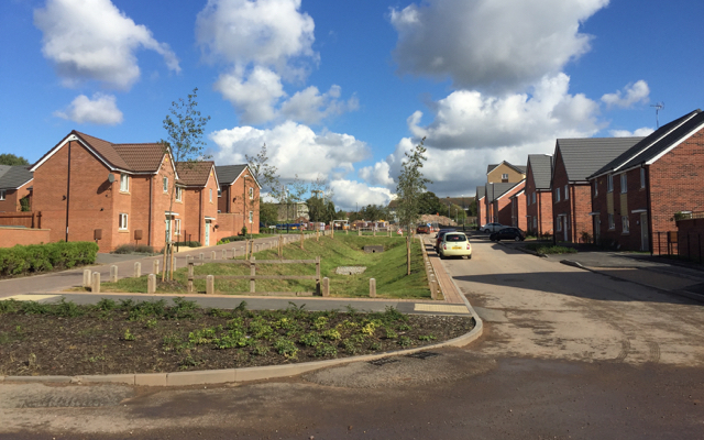 New houses and surface water channel, Bretford Road, Wood End, north Coventry