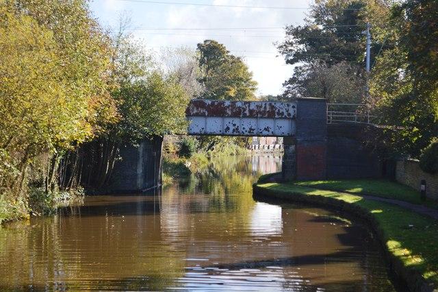 Rusty railway bridge over the Trent & Mersey Canal