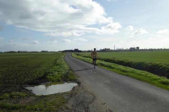 Runner passing Watergate Lane