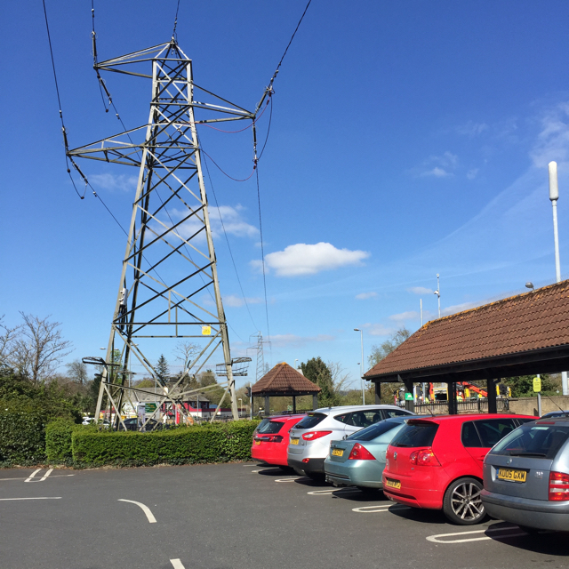 Power lines over a supermarket car park, Newton Abbot