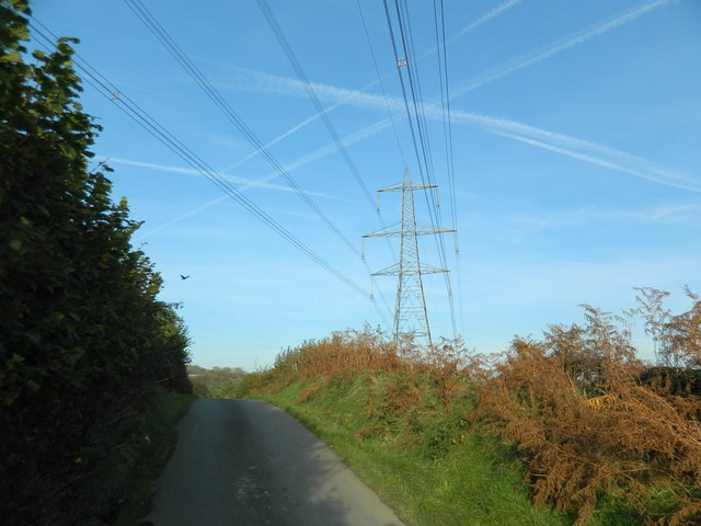 Power lines making a cats-cradle with vapour trails, near Waun Castellau