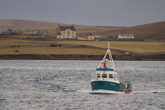 MV Shesal off Gutcher, with Belmont in the background