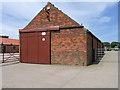 SE5967 : Barn in concrete yard by Trevor Littlewood