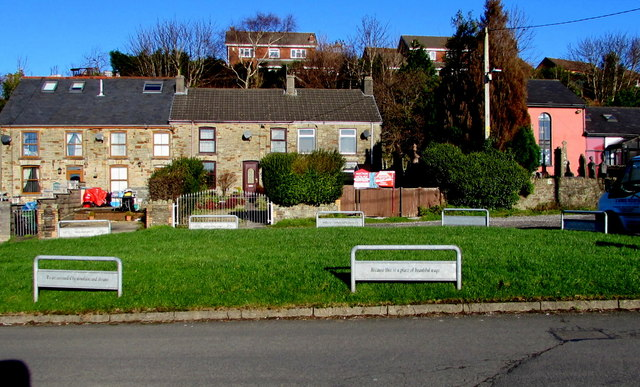 Houses on the north side of the village green, Heol Dewi Sant, Bettws
