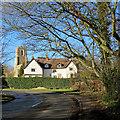 TL2147 : Sutton: a bend in the village street by John Sutton