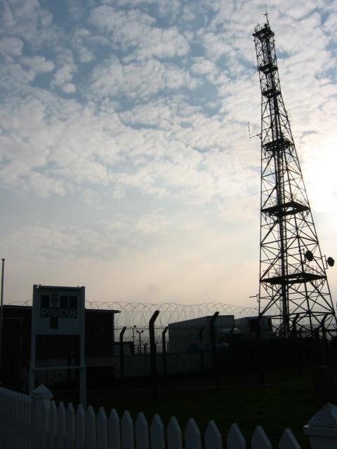 Signal mast and razor wire