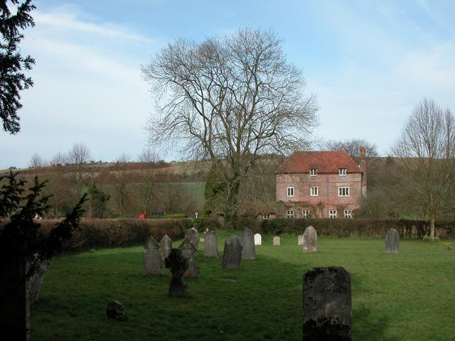 The Manor Farm House at Priors Dean from the Churchyard