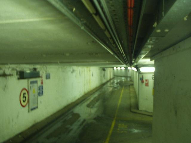 Under-station passage