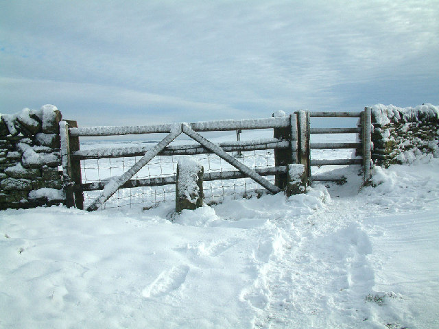 Gate in stone wall on slopes of Shining Tor