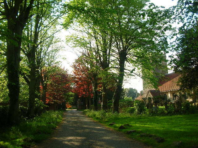 Milton Church with driveway to Manorhouse