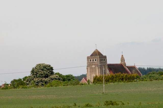 View of St Marys church, Liss across farmland.