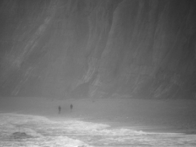 Walkers under the cliffs