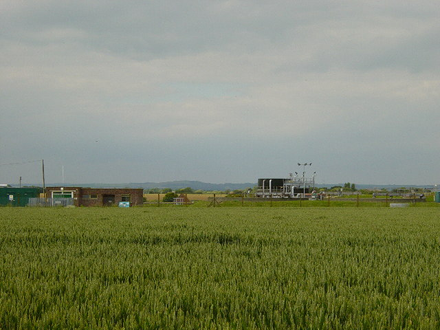 Sewage Works behind a wheat field.