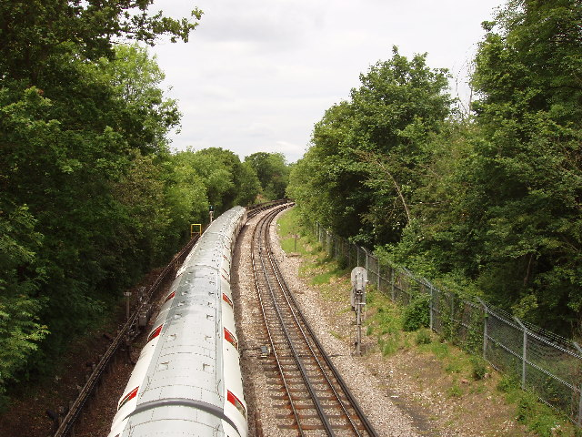 Piccadilly Line train from Wood End Road bridge