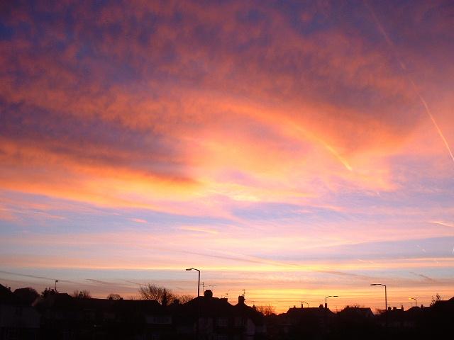 Sunrise over tarring houses