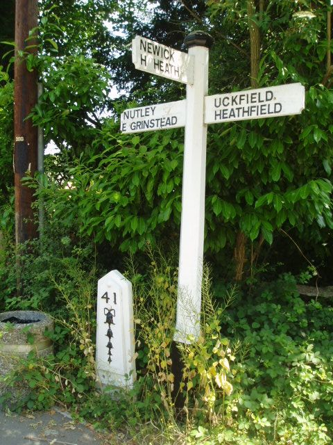 Sign post and mile post next to Chequers Inn