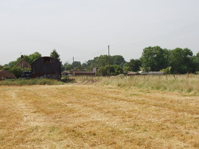 Farm with cut hayfield, near Denham Mount