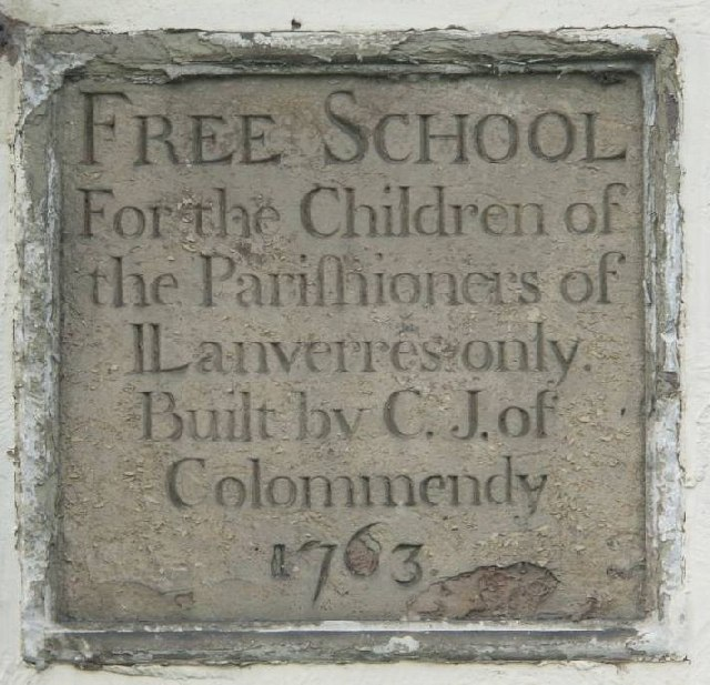 Plaque on the old British School in Llanferres