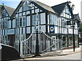 Dist:0.2km<br/>Typical Cheshire half timbered building common in Northwich town centre. The gates are for the Town Bridge which opens for boats to pass by.