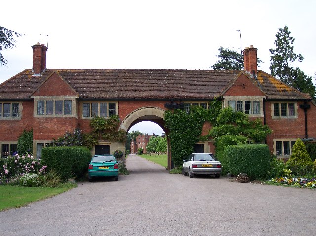 View through estate buildings to Madresfield Court