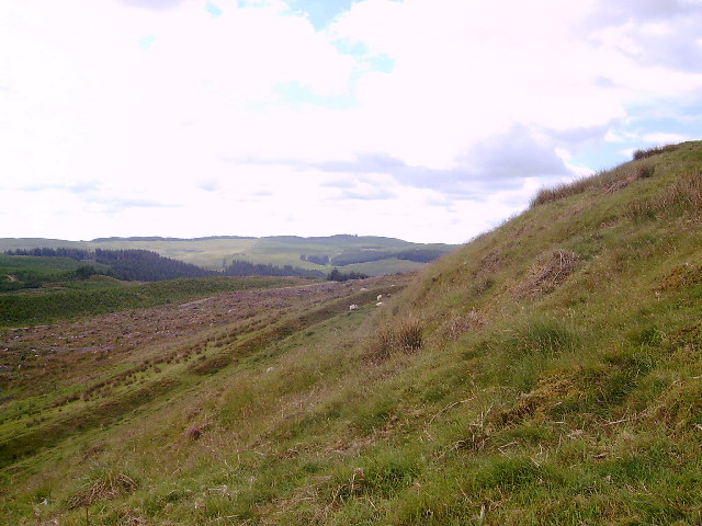 Part of the earthworks of Castle O'er iron age hill fort