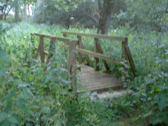 Foot bridge over which public footpath crosses