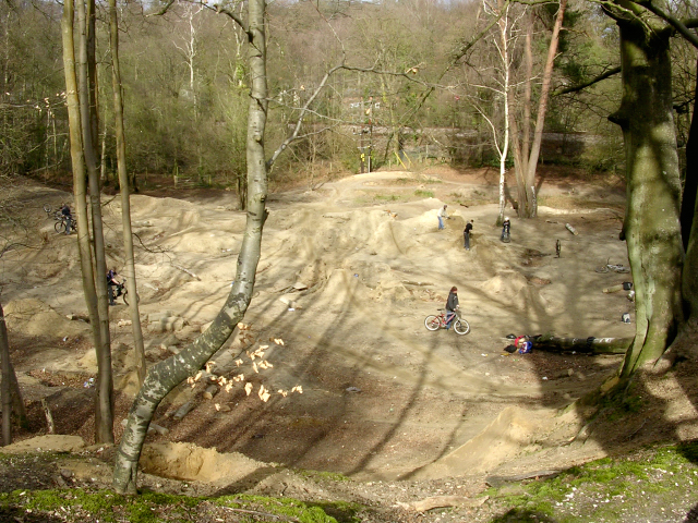 Old quarry at Buckland Rings being used by mountain bikers