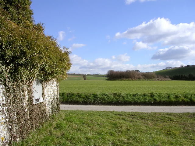 Long barrow and derelict cottage at Stocks Farm